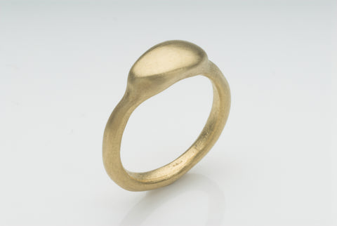 Gold Petra ring with smooth pebble shape available in 9 ct, 14 ct or 18 ct gold.