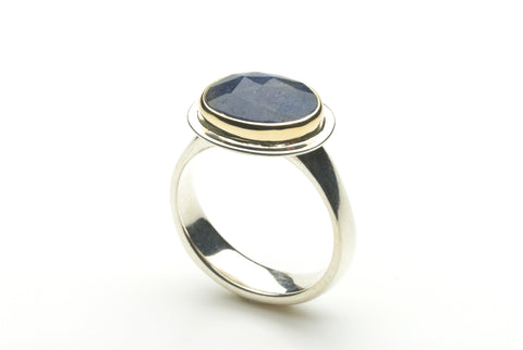 Faceted blue sapphire platform ring set in 18 ct gold by Michele Wyckoff Smith.