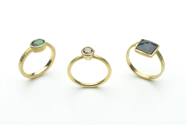 Green tourmaline ring, mauve diamond ring and square faceted lapis lazuli gold rings by Michele Wyckoff Smith.