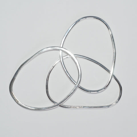 Three oval shaped bangles made by Michele Wyckoff Smith
