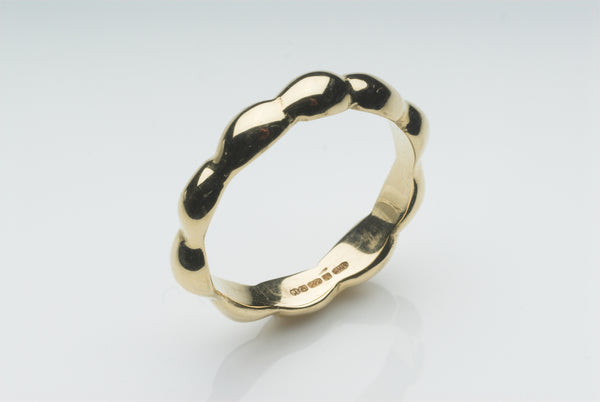 Gold Kelp Wedding Ring inspired by seaweed on the coast of New England. Available for purchase on www.wyckoffsmith.com