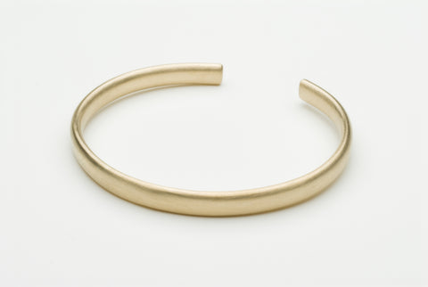 Gold cuff by Michele Wyckoff Smith.