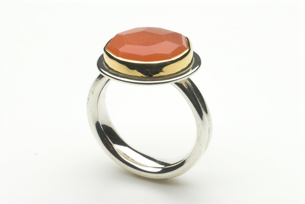 Peach faceted moonstone platform ring by Michele Wyckoff Smith.