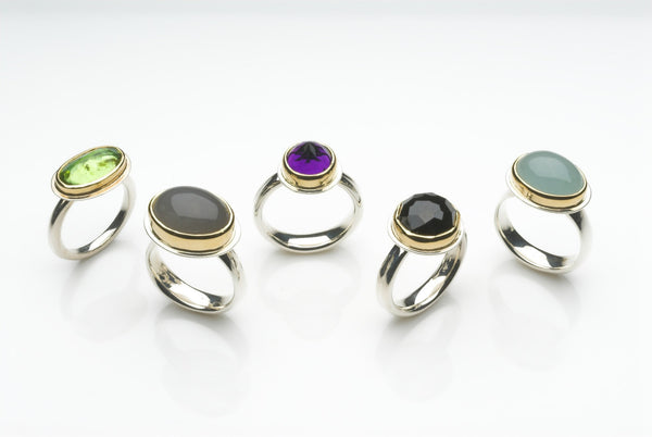 Assorted platform rings: peridot, grey moonstone, amethyst, onyx and aquamarine.