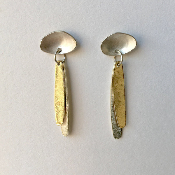 Silver and gold vermeil petal stud earrings.