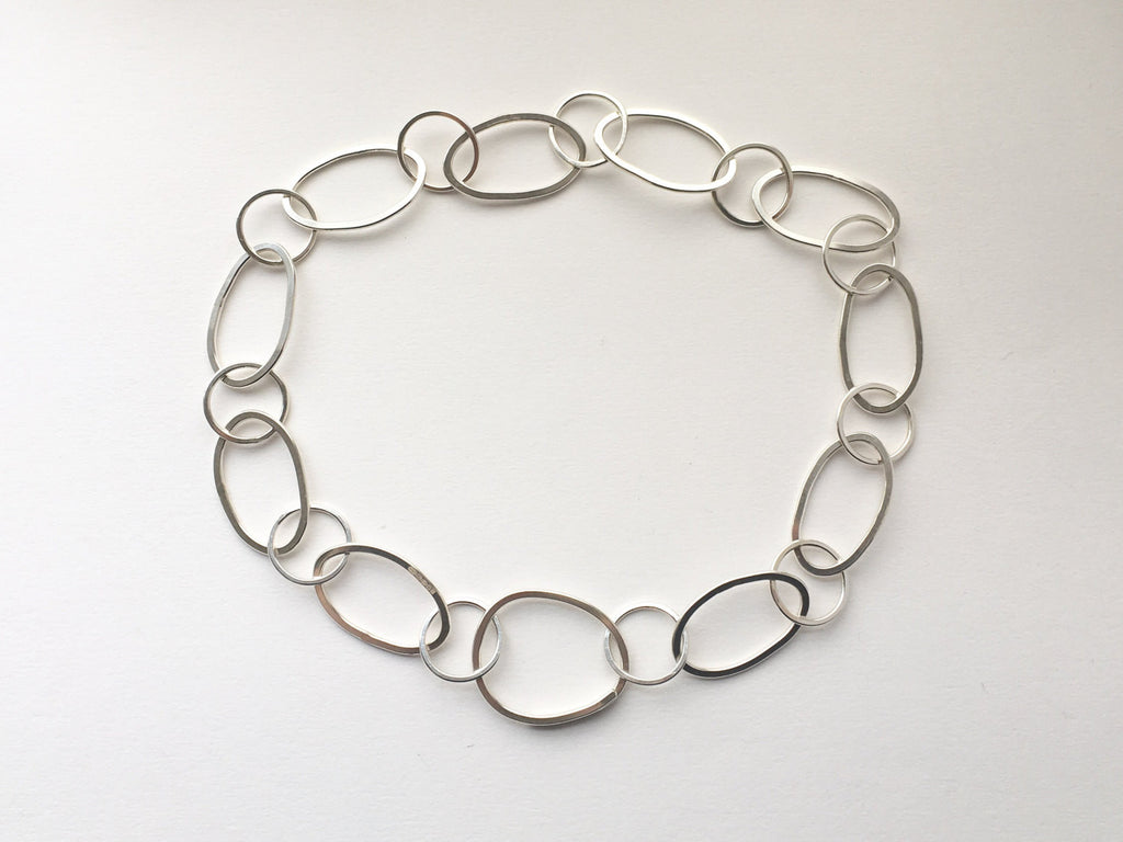 Handmade hammered oval silver chain from modular jewellery Olga Collection.
