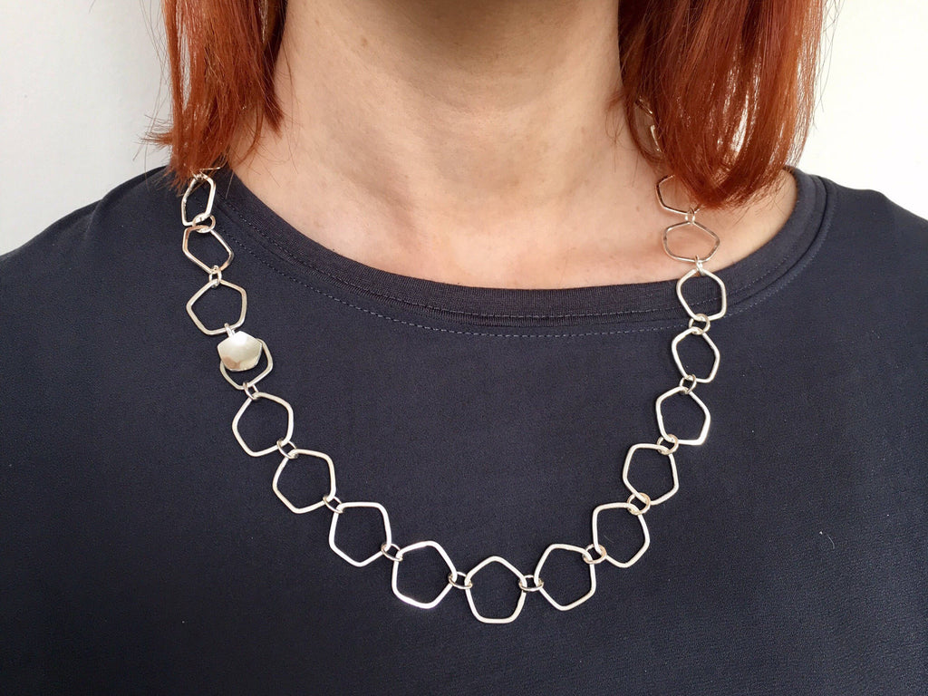 Open Calyx silver chain with hammered texture and easy clasp.