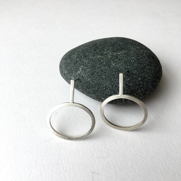 Oval dangle stud earrings available in matte or polished finish.