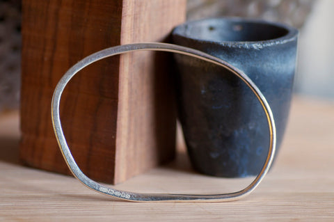 Hand Forged Oval Silver Bangle - 22.5 cm circumference
