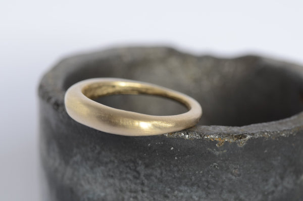 Two modern stacking rings: one 18 ct gold band and silver ring