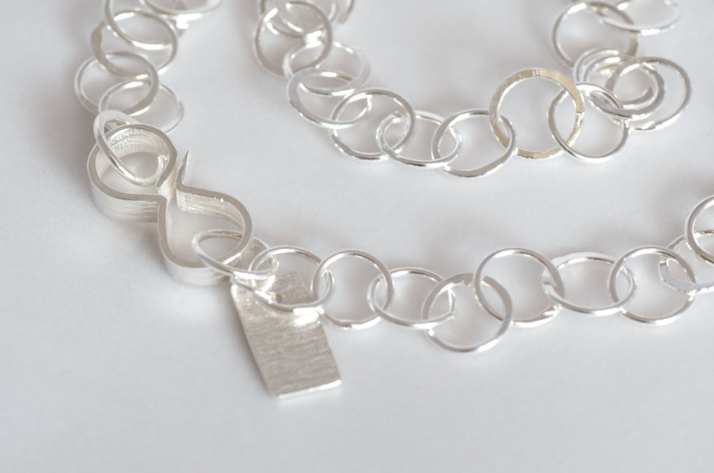 Handmade hammered silver circular chain in varied lengths.