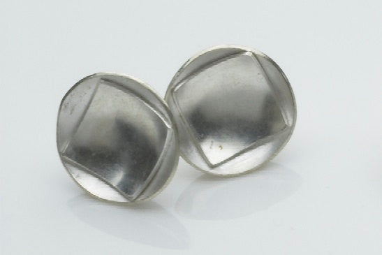 Circled square silver earrings.