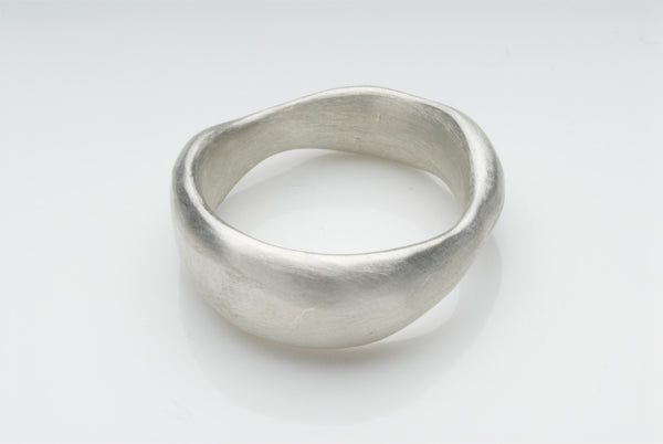 Organic shaped chunky wide wedding band.