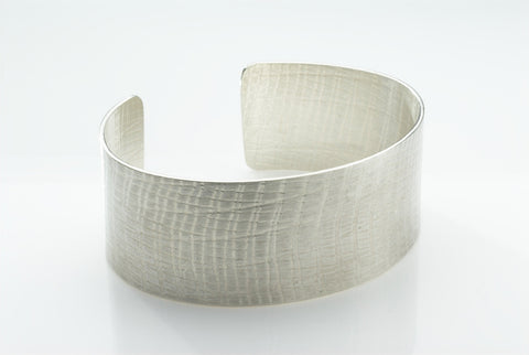 "1"" wide woven texture simple silver cuff. Available in lots of textures."