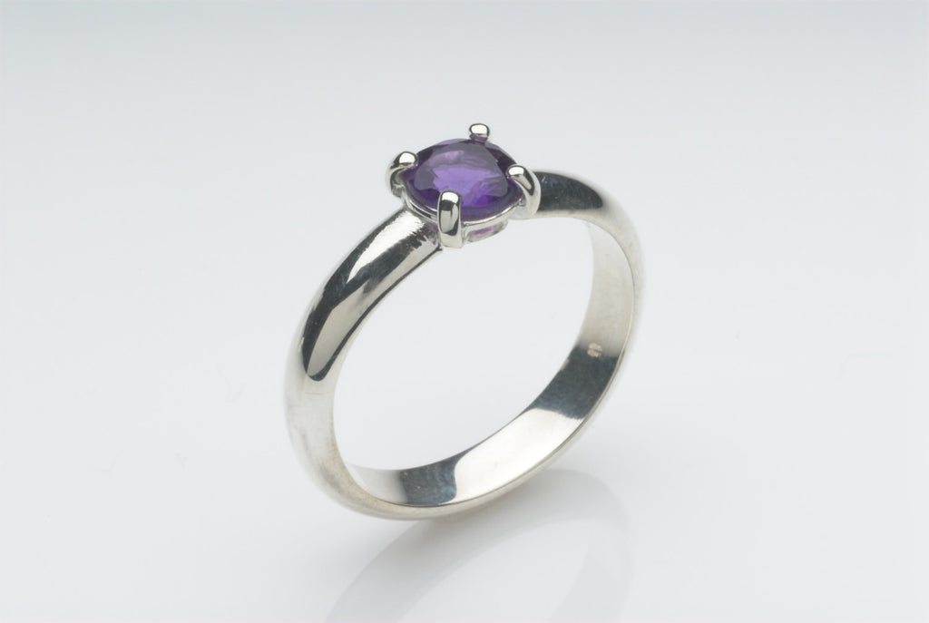 Solitaire Amethyst silver ring with wide D shaped band.