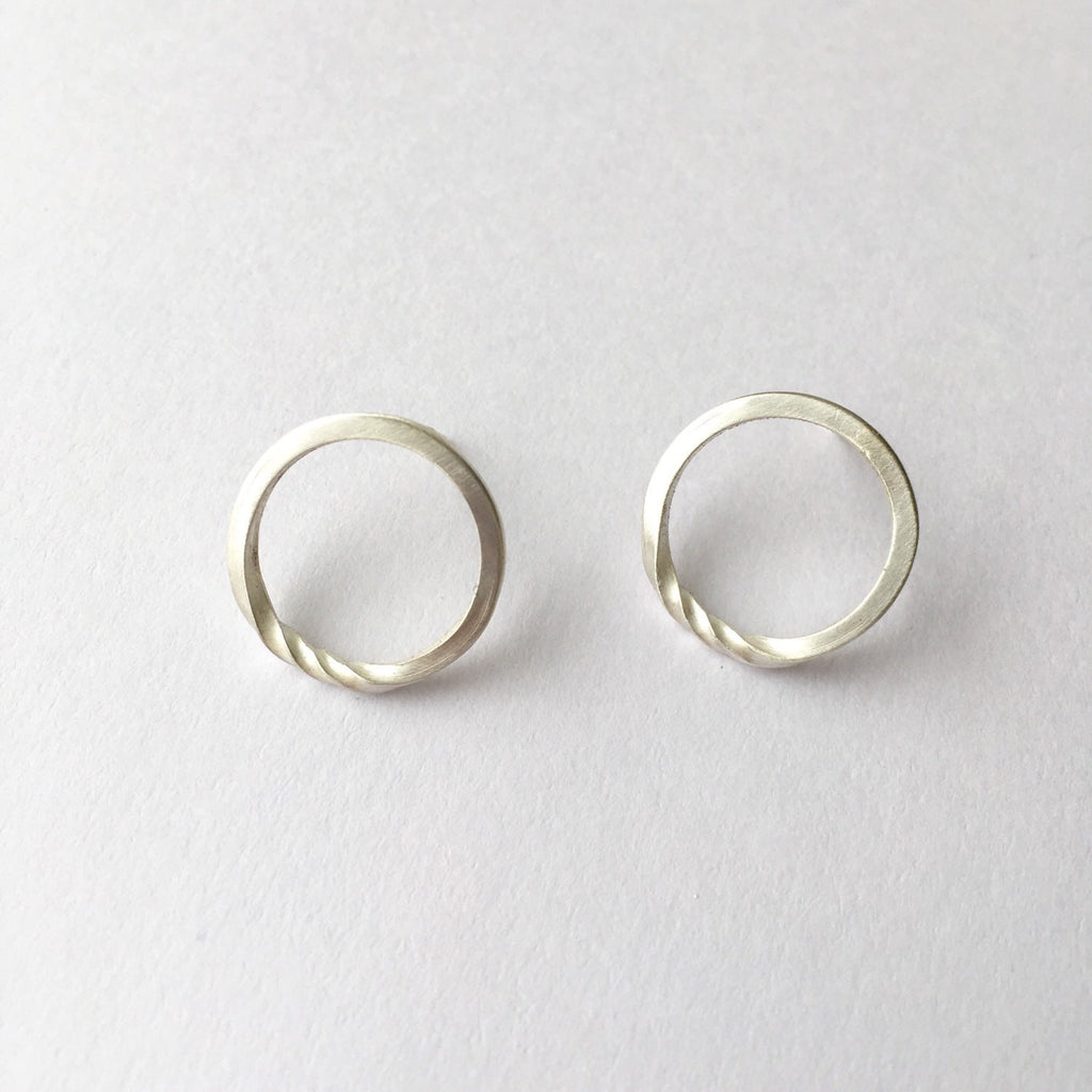 Twisted silver minimalist round stud earrings.