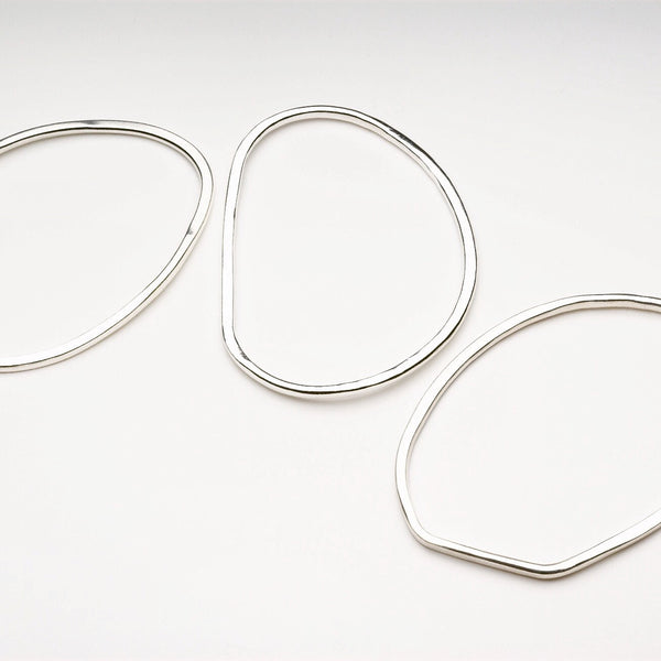Trio of Oval Shaped Hammered Bangles