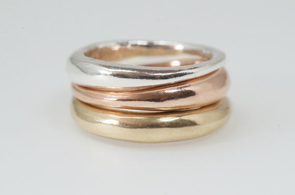 Modern stacking wedding rings in silver, rose gold and yellow gold.