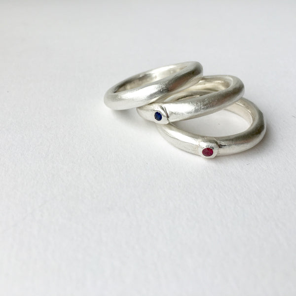 Ruby and sapphire chunky men's engagement rings by Michele Wyckoff Smith.