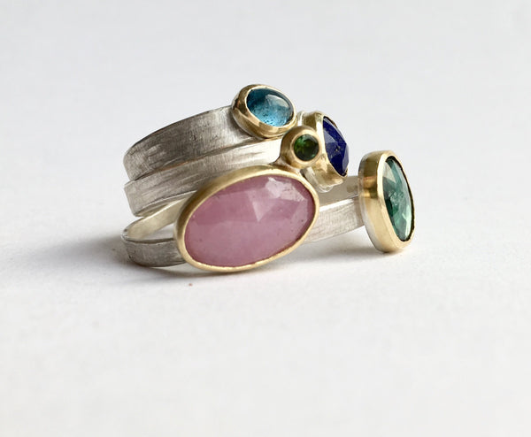 Stack of brightly coloured gemstone stacking rings by Michele Wyckoff Smith