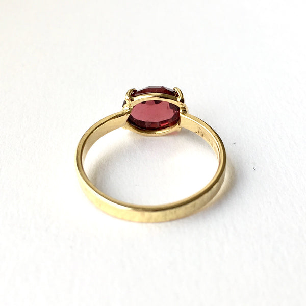 Wyckoff Smith Jewellery - back view of rose cut garnet ring in prong setting with textured ring shank.