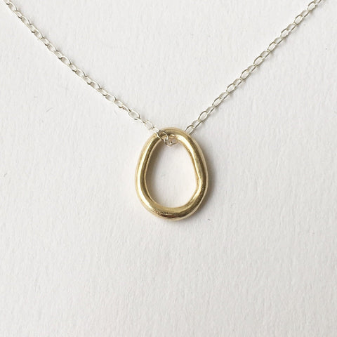 Anika Organic Shaped Oval pendant in 14 ct gold on silver chain by Michele Wyckoff Smith