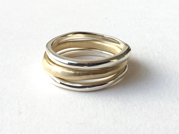 Stacking organic shaped silver and gold bands by Michele Wyckoff Smith