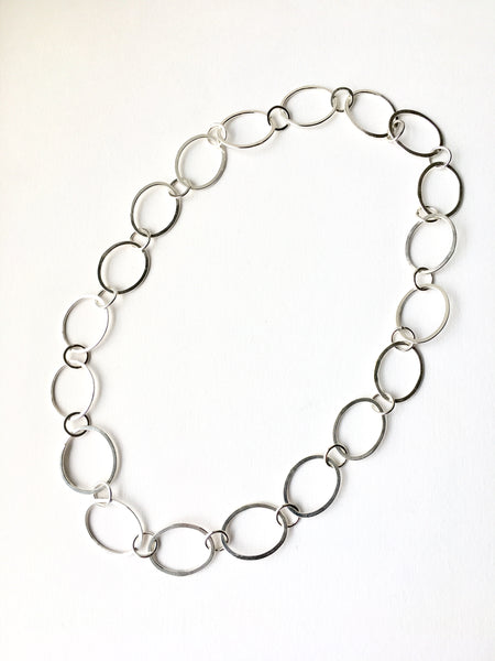Hammered oval silver chain on www.wyckoffsmith.com.