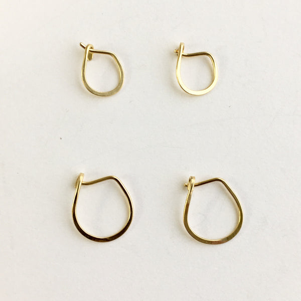 18 ct yellow gold hammered hoops by Wyckoff Smith Jewellery