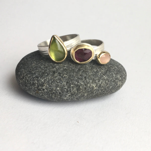 Three stacking rings by Michele Wyckoff Smith on www.wyckoffsmith.com left to right: green vesuvianite (idiocrase), deep pink tourmaline and peach moonstone