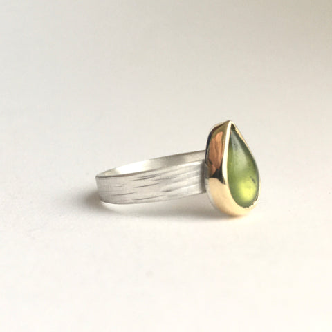 Side view of pear shaped green idiocrase vesuvianite stackinging ring set in 18 ct gold on a silver textured band on www.wyckoffsmith.com. Perfect for a volcanologist