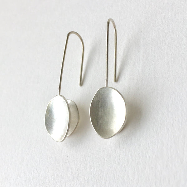 Silver oval organic shaped earrings by Michele Wyckoff Smith.