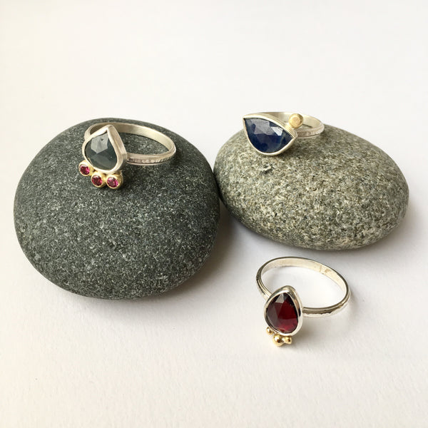 Hand forged silver rings with garnets and sapphires by Michele Wyckoff Smith