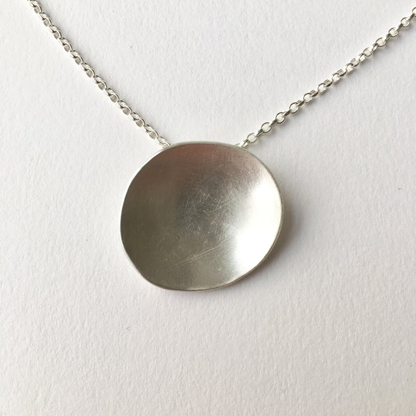 Horizontal concave oval pendant by Michele Wyckoff Smith