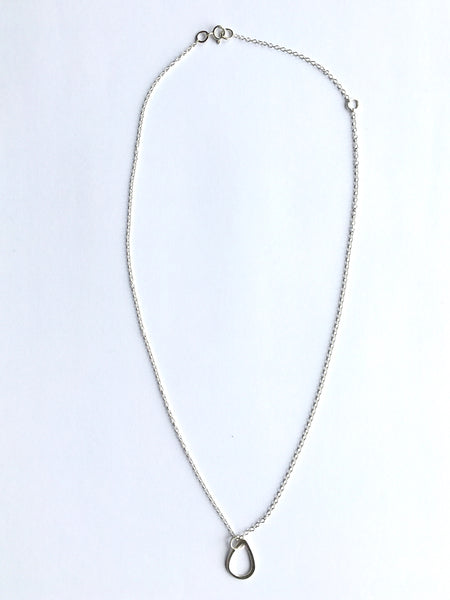 "Overview photograph of silver teardrop shape pendant on adjustable 16"" or 18""  silver chain. www.wyckoffsmith.com"