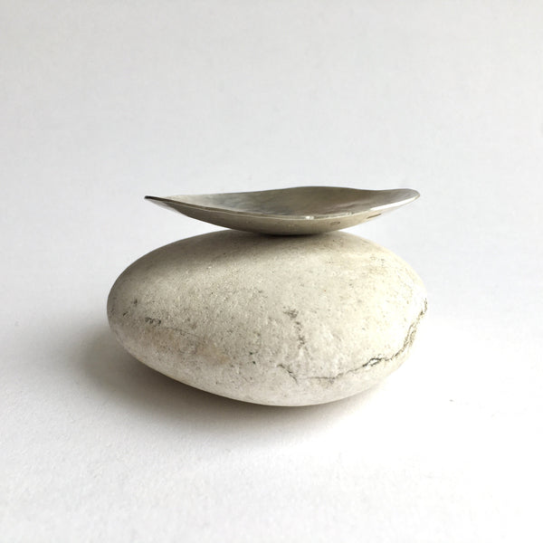 Profile of large oval tea caddy spoon on white pebble by Michele Wyckoff Smith UK