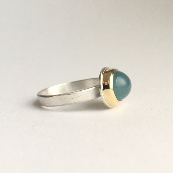 Side view of blue grey aquamarine ring set in 18 ct gold on hammer textured silver ring by Michele Wyckoff Smith on www.wyckoffsmith.com silver and gold jewellery