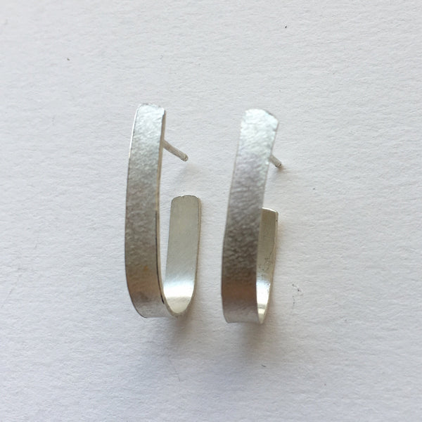 Textured silver modern hoop earring by Michele Wyckoff Smith