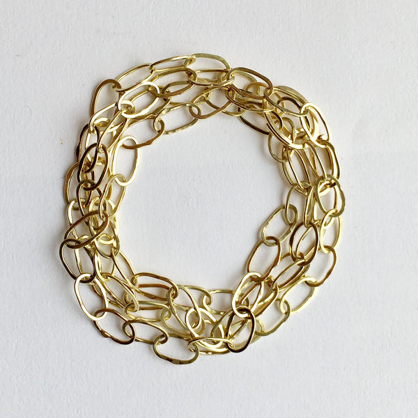 Odd Fellow necklace and bracelet combined to make multi layer chain bracelet by Wyckoff Smith Jewellery