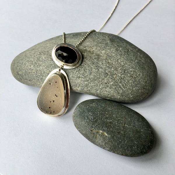 Oval faceted black onyx and speckled white and black druzy pendant on stones. Available on www.wyckoffsmtih.com