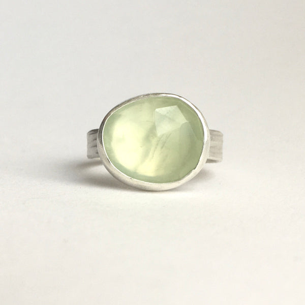 Front view of faceted prehnite gemstone ring set in silver with a horizontal hammered texture ring available on www.wyckoffsmith.com