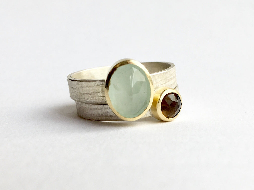 Aquamarine and smokey topaz stacking rings. Gemstones are set in 18 ct gold bezels on silver rings. Wyckoff Smith Jewellery
