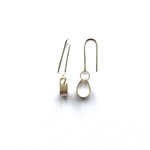 Side view and front view of Swing Petal Silver earrings on www.wyckoffsmith.com