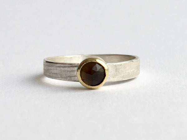 Front view of faceted 5 mm smokey topaz set in 18 ct gold bezel by Michele Wyckoff Smith