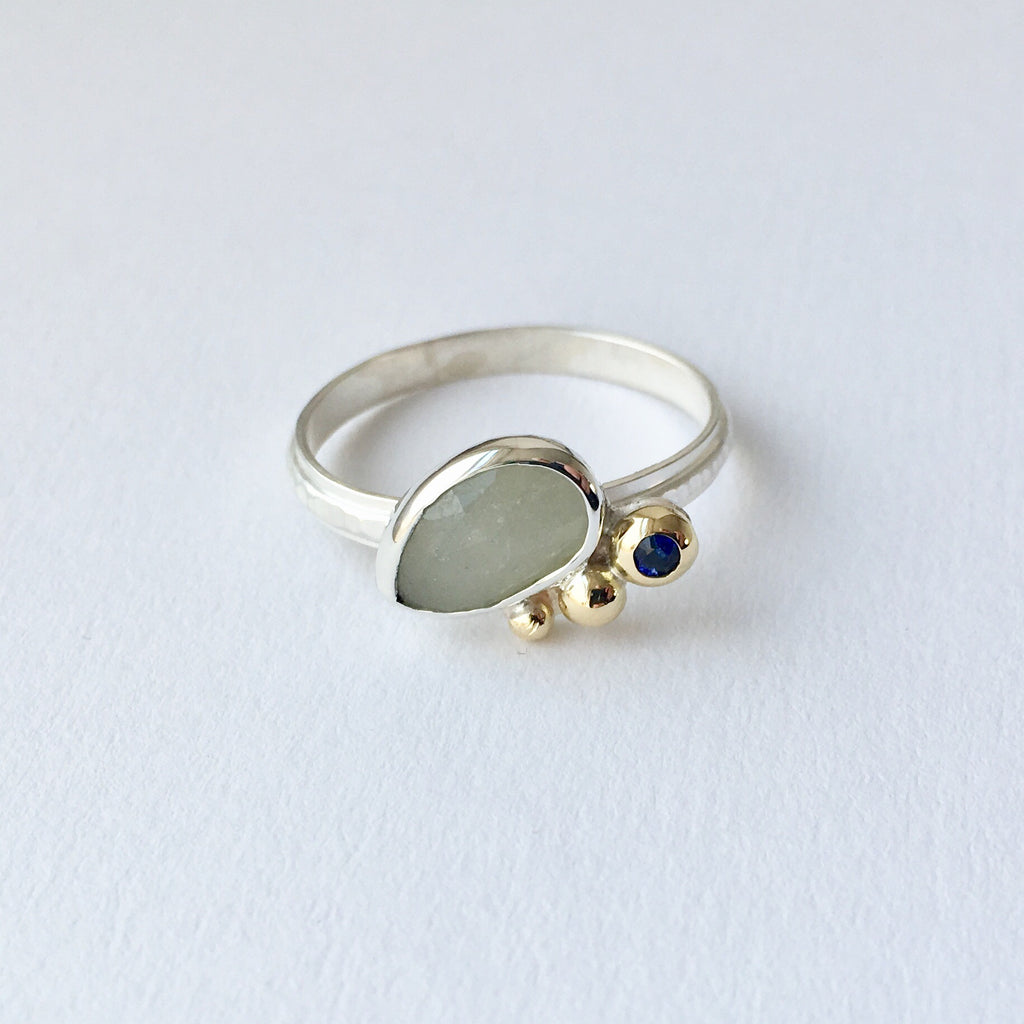 Grey and blue sapphire ring made in sterling silver with 18 ct gold balls.