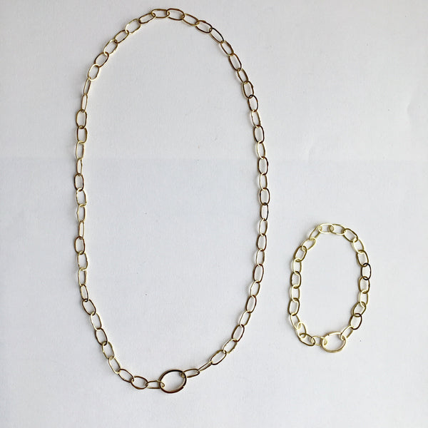 Comparison photograph of Odd Fellow necklace and bracelet in 18 ct gold by Wyckoff Smith Jewellery