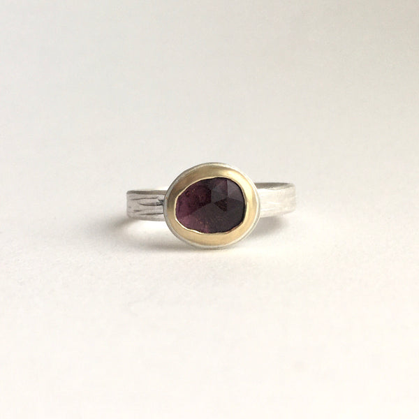 Front view of pink rose cut tourmaline set in 18 ct gold on a textured silver band on www.wyckoffsmith.com