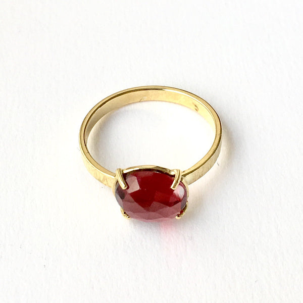 Wyckoff Smith Jewellery - rose cut garnet ring in prong setting with textured ring shank.