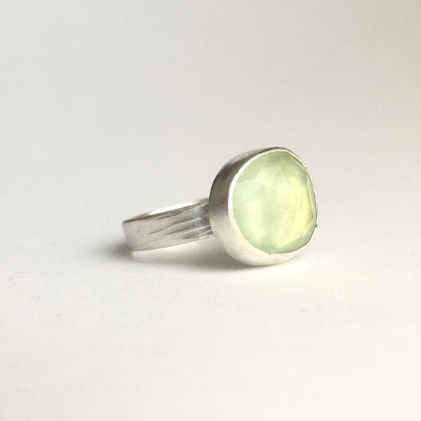 Pale green faceted prehnite stone set in sterling silver with a textured silver band by Michele Wyckoff Smith