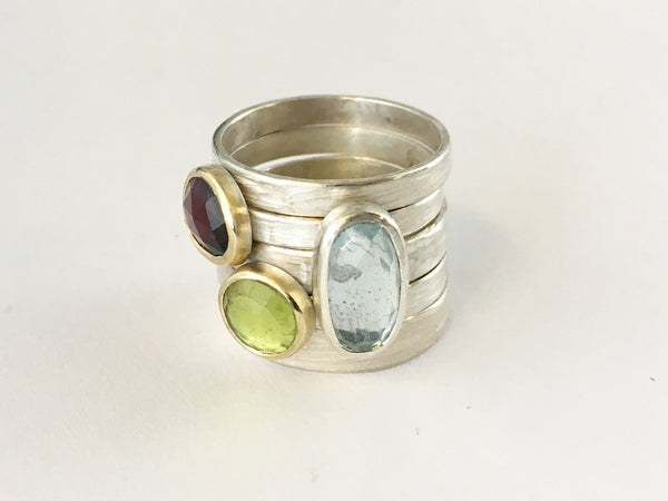 Stacking gemstone rings by Michele Wyckoff Smith - garnet, peridot and blue topaz gemstone rings sold separately on www.wyckoffsmith.com
